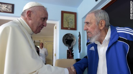 Pope Francis and Cuba's Fidel Castro shakes hands, in Havana, Cuba, Sunday, Sept. 20, 2015. The Vatican described the 40-minute meeting at Castro's residence as informal and familial, with an exchange of books. (AP Photo/Alex Castro)