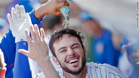 Fernando Rodney of the Chicago Cubs  pours sunflower seeds onto Kris Bryant in 2015.