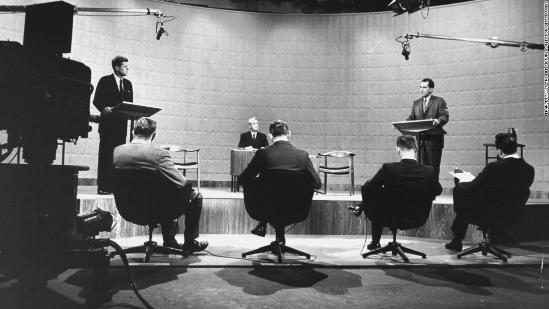 The debate started with eight-minute opening statements and then moved on to alternating questions from panelists, seen here in the foreground.