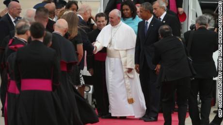 JOINT BASE ANDREWS, MD - SEPTEMBER 22:  Pope Francis shakes hands with Vice President Joe Biden along with U.S. President Barack Obama, first lady Michelle Obama, and other political and Catholic church leaders after arriving from Cuba September 22, 2015 at Joint Base Andrews, Maryland. Francis will be visiting Washington, New York City and Philadelphia during his first trip to the United States as Pope. (Photo by Chip Somodevilla/Getty Images)