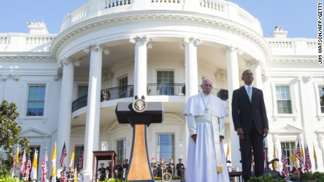 President Barack Obama stands alongside Pope Francis during an arrival ceremony on the South Lawn of the White House on September 23, 2015.