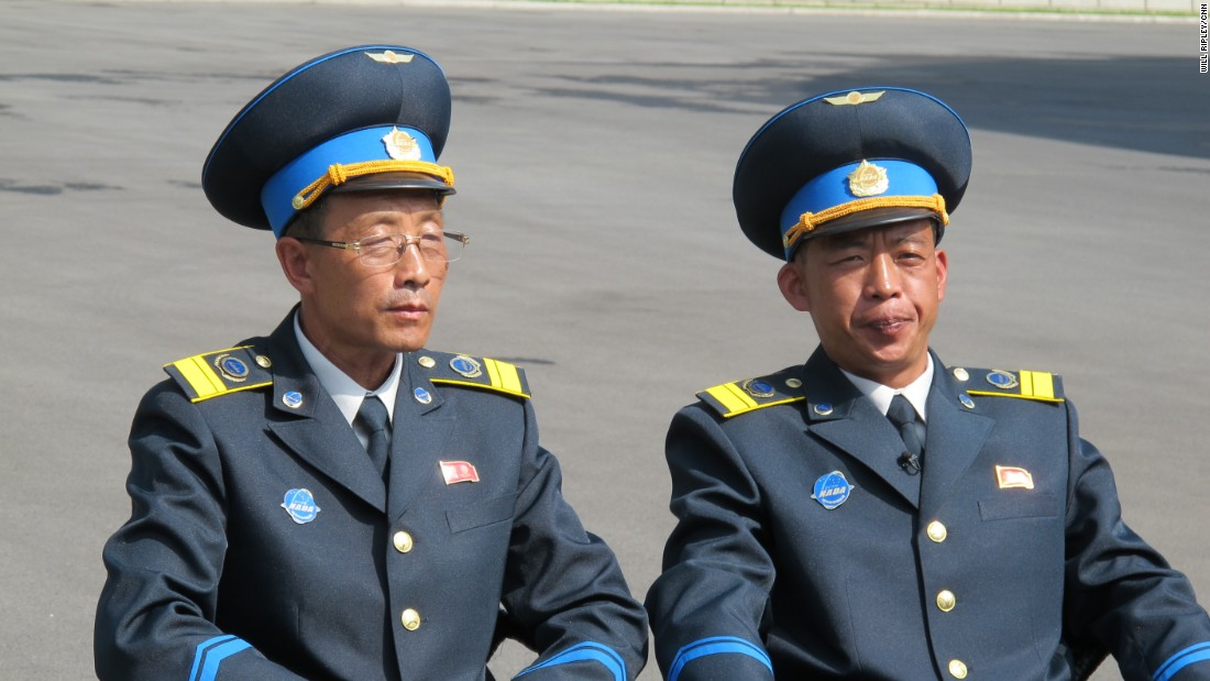 The space program's two top scientists are dressed in smart, newly designed uniforms. They wear a red pin on the left side of the jacket with the portraits of former leaders Kim Il Sung and his son, Kim Jong Il. Pinned on the right side is NADA's logo, which bares a striking similarity to NASA, its counterpart in the land of its great enemy -- the United States.