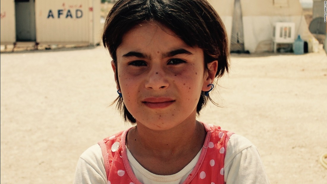 Miada Murad is eight years old, from Sinjar. She has five sisters.