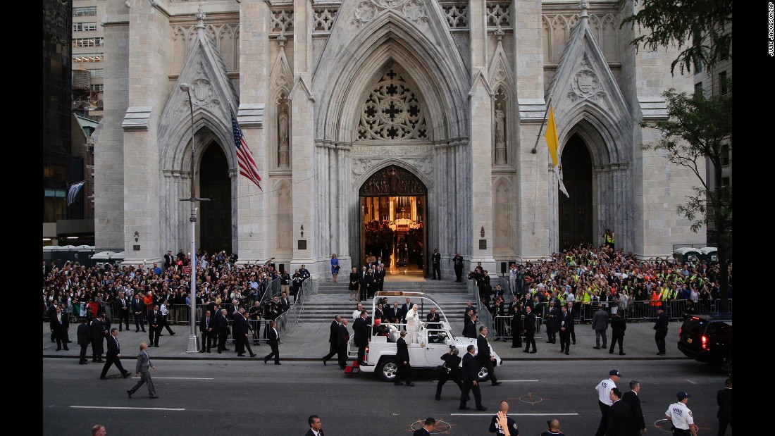 Francis greets crowds as he arrives at St. Patrick's Cathedral.