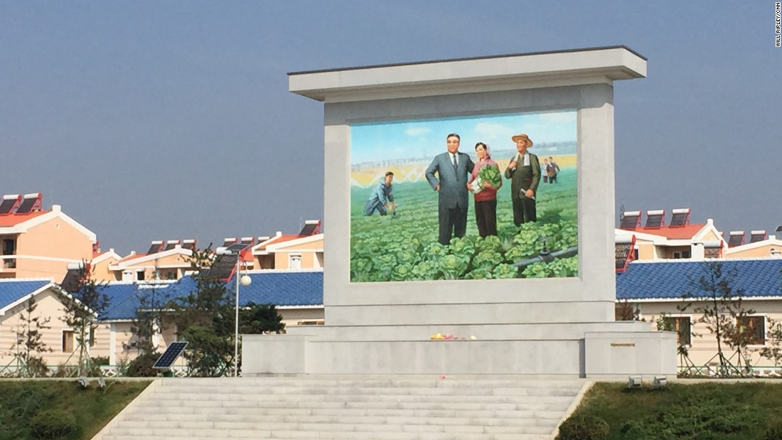 "A large mural of North Korean founder Kim Il Sung stands outside the Jang Chon cooperative farm, a 30-minute drive outside the capital Pyongyang. <a href=""http://www.cnn.com/2015/09/25/asia/north-korea-most-famous-farmer/"">CNN visited the farm in September 2015.</a>"