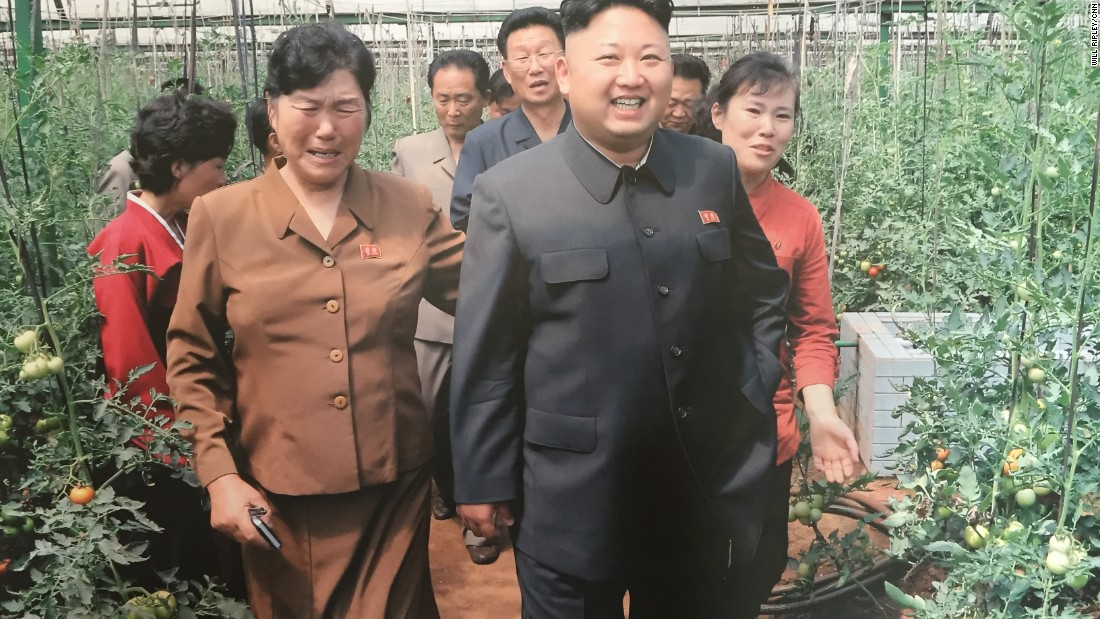"Kim Myong Yon, left, longtime manager of the Jang Chon cooperative farm, sobs as she gives North Korea's current supreme leader Kim Jong Un a tour of the greenhouse. ""I was crying very heavily. It was so hot inside (the greenhouse). We felt so sorry for the leader's health,"" she said."