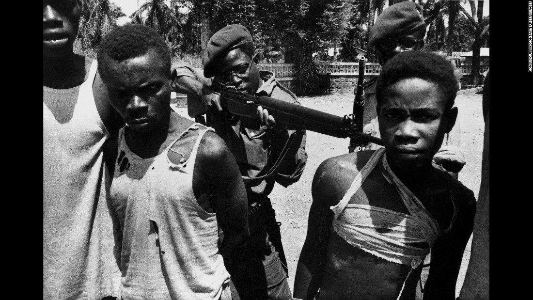 Suspected Lumumbist freedom fighters are tormented before execution in Stanleyville, Democratic Republic of Congo, in 1964.