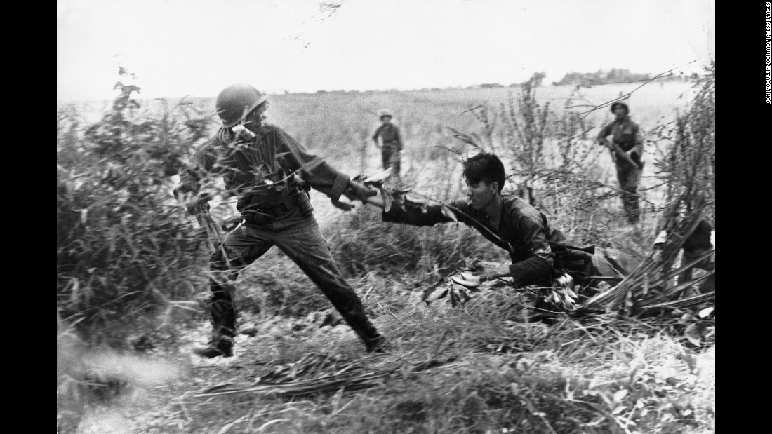 A Vietcong suspect is dragged from his bunker, in South Vietnam in 1965.