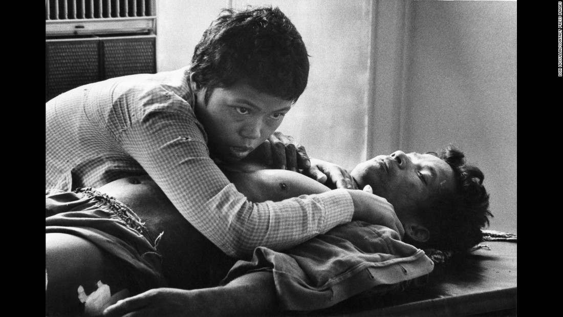 A Cambodian woman clutches the body of her husband, who was killed in the battle for Phnom Penh in 1975.
