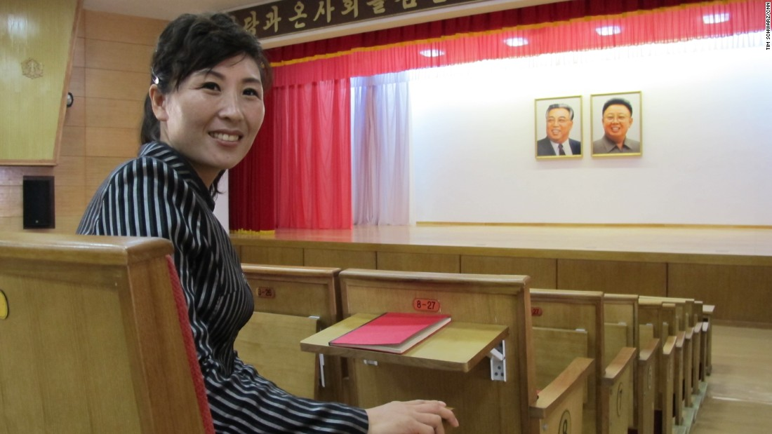 Pak Myong Sim works full-time at the farm -- her job is to show visitors around. She said this auditorium holds events for entertainment and political education. Tables are built-in to the seats to facilitate note-taking. The ubiquitous portraits of Kim Il Sung and Kim Jong Il are of course present,  hung over the center of the stage.