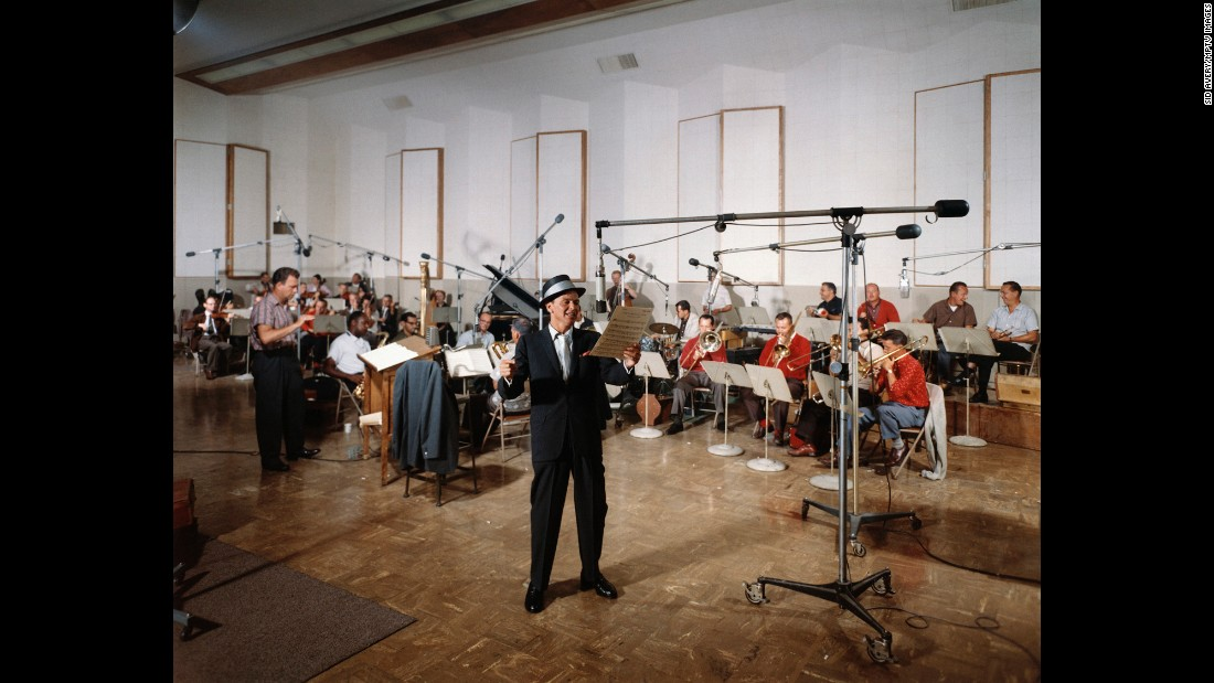 "Perhaps Sinatra's most fruitful musical collaboration was with arranger Nelson Riddle. They recorded the albums ""In the Wee Small Hours"" and ""Only the Lonely,"" among others. Here, Sinatra records his 1961 album, ""Sinatra's Swingin' Session!!!"" in Capitol Records' Studio A. Riddle stands on the left."