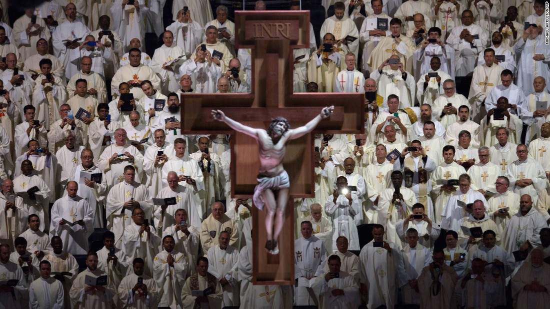 A crucifix hangs above members of the clergy during Mass at Madison Square Garden on September 25.