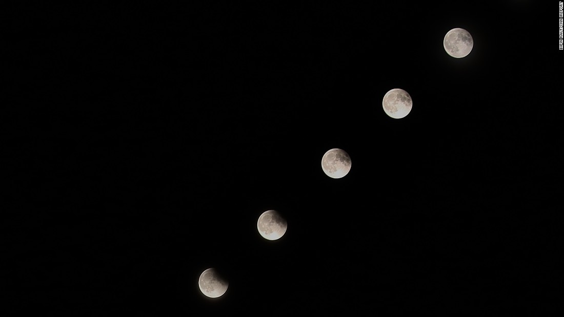 "<a href=""http://ireport.cnn.com/docs/DOC-1273237"">Bipin Raut</a> did this composition of the supermoon eclipse from his home in Plano, Texas."