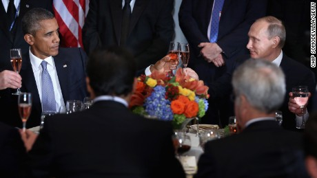 President Barack Obama (left) and Russian President Valdimir Putin toast during a luncheon hosted by United Nations Secretary-General Ban Ki-moon during the 70th annual UN General Assembly on September 28, 2015, in New York City.