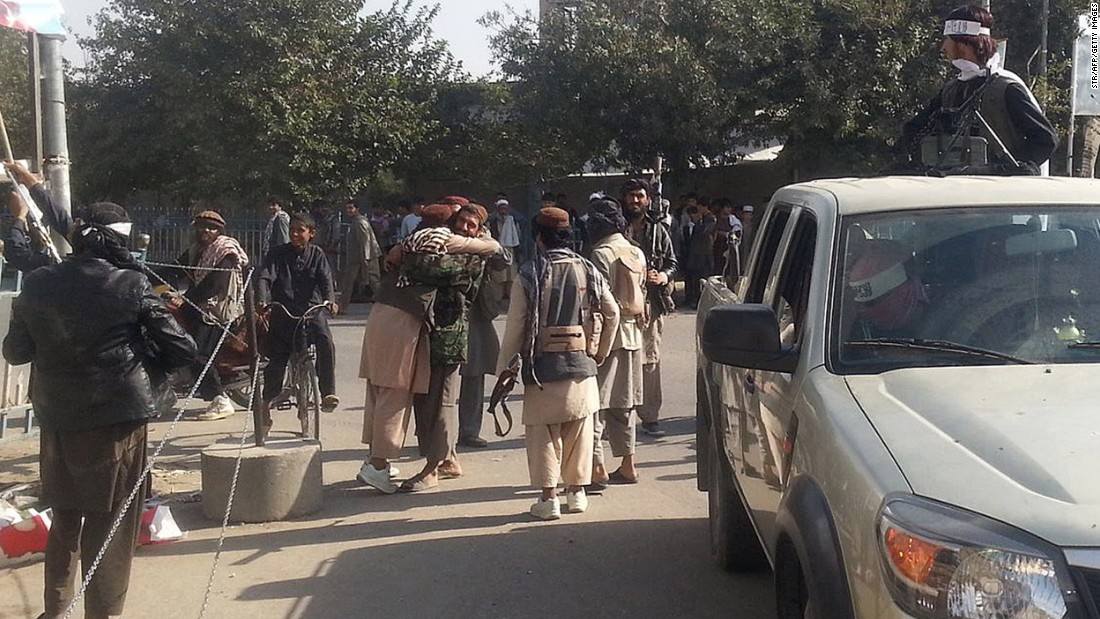 Taliban fighters hug each other on September 29.