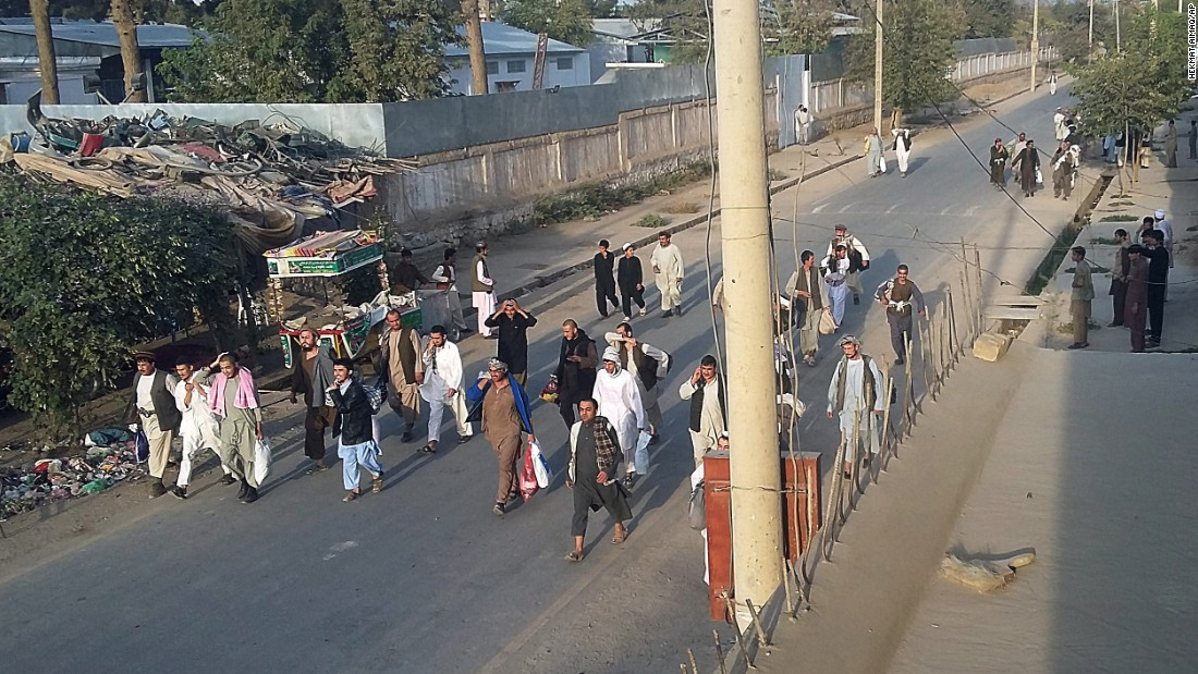 Taliban prisoners walk down a street after they were released by Taliban fighters from the main jail in Kunduz on Monday, September 28.