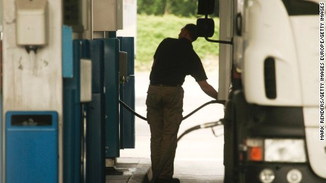 LUXEMBOURG - MAY 29:  A truck driver fills the tank of his lorry with diesel at a fuel station on May 29, 2008 in Luxembourg city. Customers are driving up to 100 km from neighbouring countries Belgium, France and Germany to fill up their vehicles with fuel, which is much cheaper in Luxembourg due to lower taxes.  (Photo by Mark Renders/Getty Images)