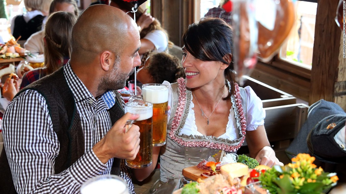 Prost! Guardiola and his wife Cristina Serra (R) raise a glass to one another. Let's hope the club's Spanish coach just had the one given he will need a clear head as the Bundesliga leaders prepare to face second place Borussia Dortmund on Sunday.
