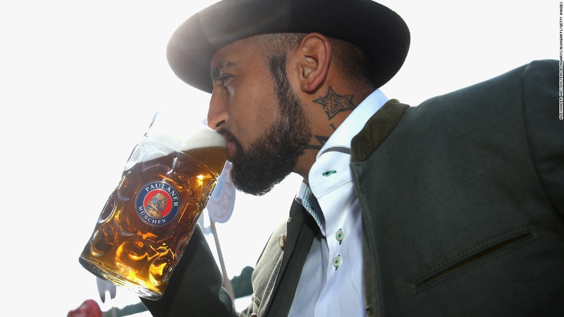 Chilean midfielder Arturo Vidal takes a swig from a stein in his traditional Bavarian outfit.