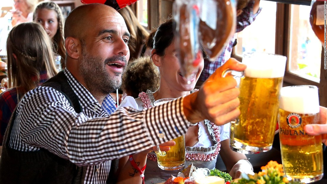 Last December, while still taking time away from football, Tuchel met Pep Guardiola (pictured) at a bar in Munich. The bar is a favored haunt of Bayern Munich players, the team of which Guardiola is head coach. The two discussed football at length, with waiting staff wary of interrupting the intense discussion. Here, Guardiola -- revered for his all-conqeuring time as Barcelona coach between 2008 and 2012 -- enjoys a Oktoberfest drink, dressed in traditional Bavarian attire. Guardiola and Tuchel will be in opposing dugouts when Bayern and Dortmund go head-to-head on Sunday.