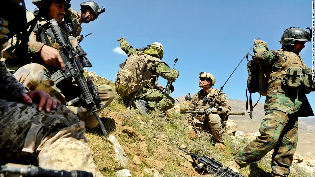 <strong>3. They can carry up to 100 pounds of gear in their rucksacks</strong><br /><br />In this photo, members of the 8th Commando Kandak and coalition Special Operations forces discuss troop movement during a firefight near in Daykundi province, Afghanistan, in 2012.