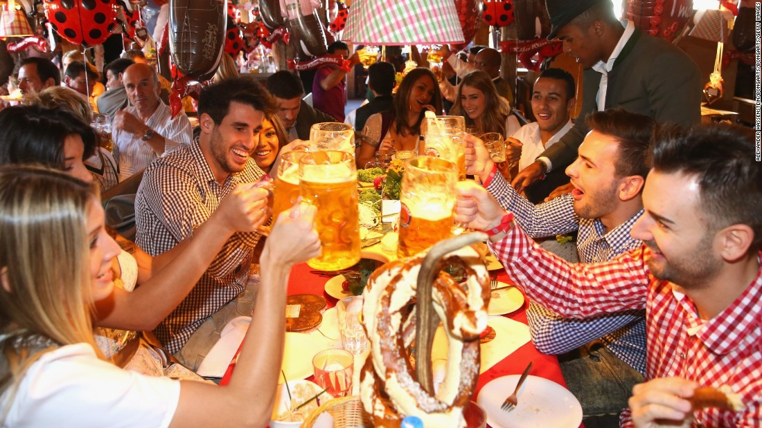 The league champions clink their glasses together. More than seven million liters of beer is drunk during two weeks of the festival.