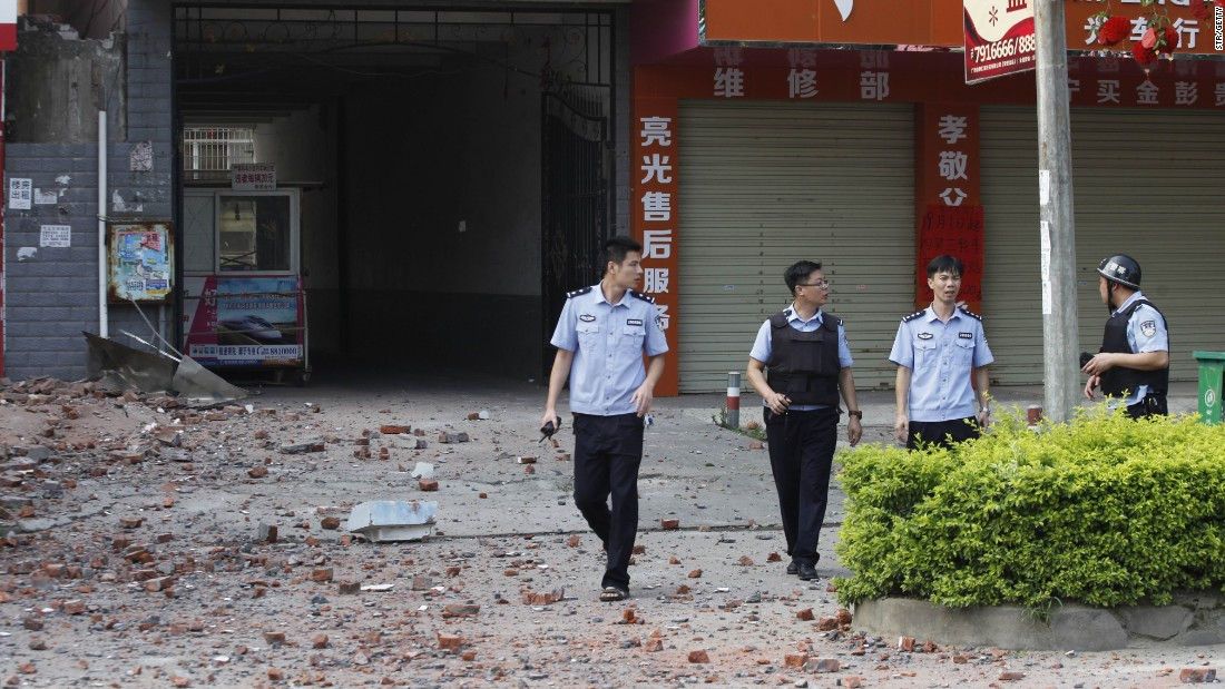 Police investigators inspect the area after a blast. The People's Daily, a national newspaper, said a man paid couriers to deliver the letter bombs across Liucheng.