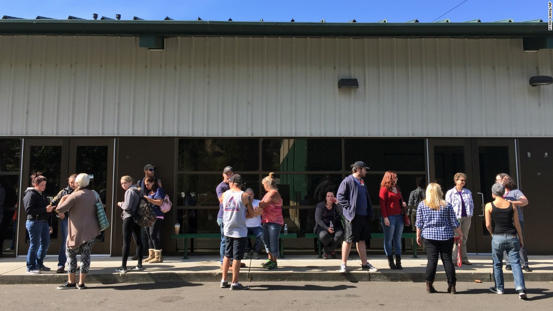 People wait for information at the fairgrounds on October 1.