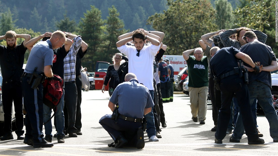 "Police search students outside Umpqua Community College after <a href=""http://www.cnn.com/2015/10/01/us/gallery/oregon-shooting-umpqua-community-college/index.html"" target=""_blank"">a deadly shooting</a> at the school in Roseburg, Oregon, in October 2015. Nine people were killed and at least nine were injured, police said. The gunman, Chris Harper-Mercer, committed suicide after exchanging gunfire with officers, a sheriff said."
