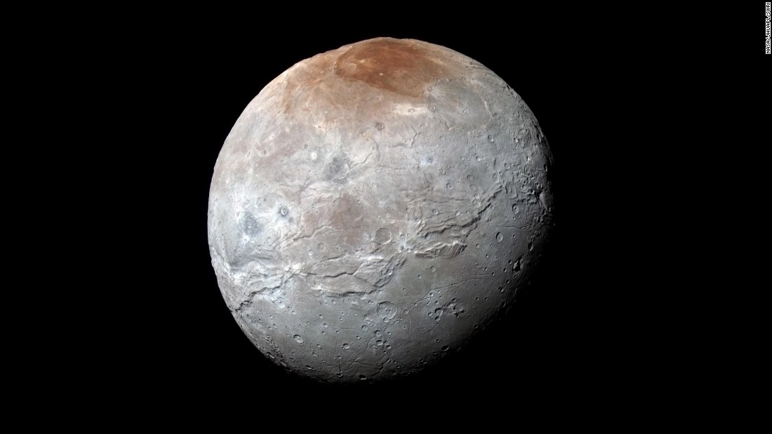 "<a href=""http://www.nasa.gov/feature/pluto-s-big-moon-charon-reveals-a-colorful-and-violent-history"" target=""_blank"">Pluto's largest moon, Charon</a>, in seen in enhanced color in this image taken by NASA's New Horizons spacecraft. The space probe took the image just before it made its closest approach on July 14. The image combines blue, red and infrared images to best highlight the moon's surface features. Charon is 754 miles (1,214 kilometers) across. The image was released on October 1."