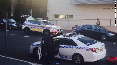 Authorities respond after a shooting outside a police headquarters near Sydney, Australia.