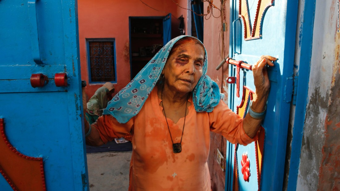Asghari Begum, mother of the victim, stands by the entrance of her home in Bisara, a village near New Delhi, on September 30, 2015.