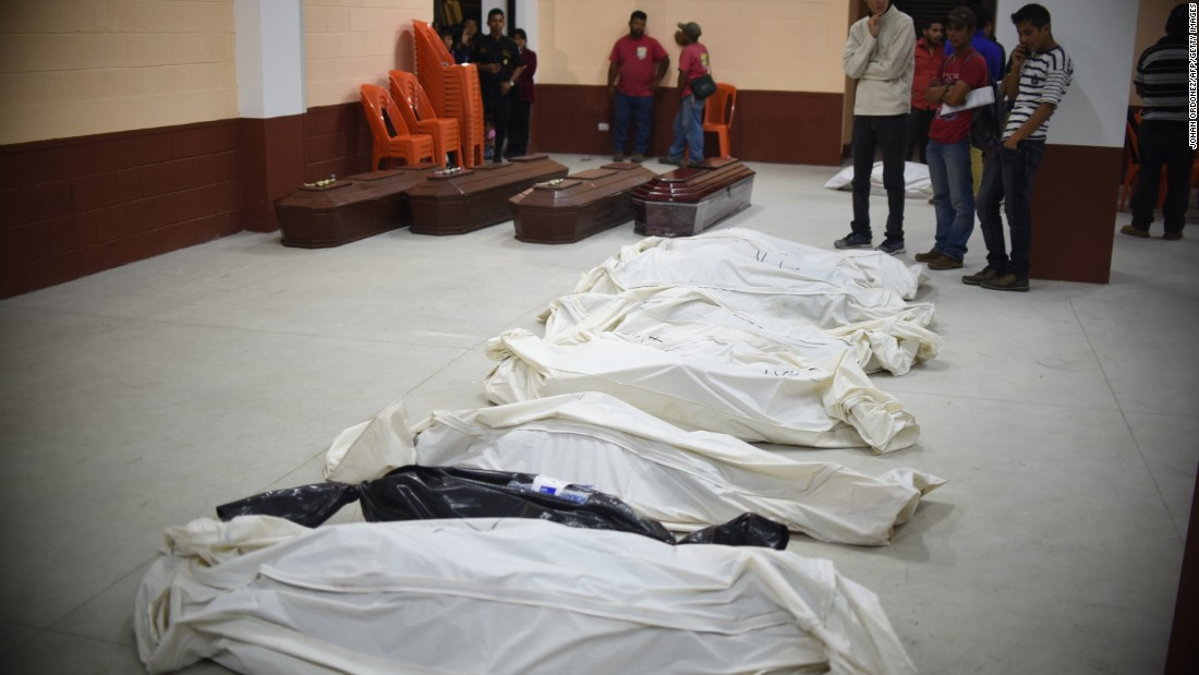 Bodies recovered from the debris are seen at a provisional morgue in Santa Catarina Pinula municipality on October 2.