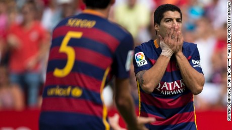 It was that kind of day for Luis Suarez, right, and Barcelona, which lost 2-1 at Sevilla in the league without Lionel Messi.