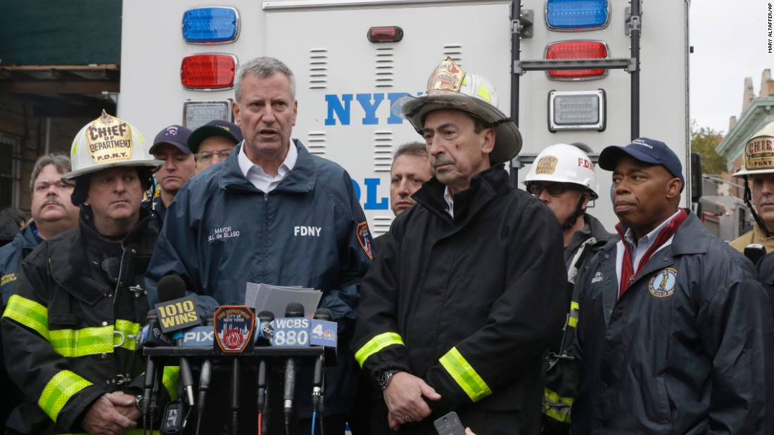 Mayor Bill de Blasio, Fire Commissioner Daniel A. Nigro and Brooklyn Borough President Eric Adams speak to reporters.
