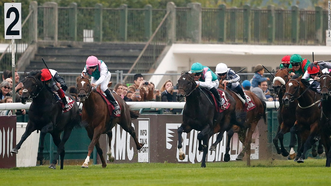 Dettori on the far left with Golden Horn drives to the front with two furlongs remaining of Europe's richest horse race