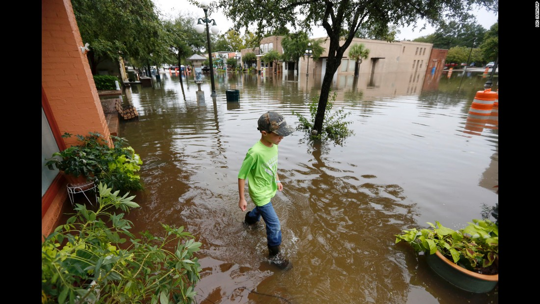 Tripp Adams, 8, walks through flood waters in Georgetown, South Carolina, on October 4.