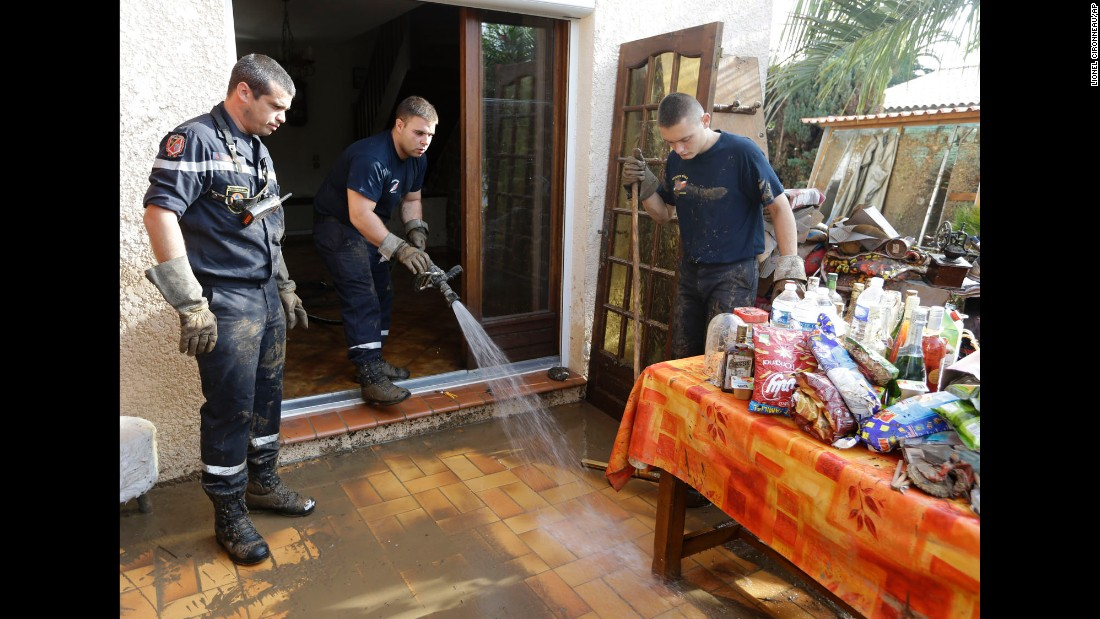 Rescue workers help clean a house in Biot on October 5.