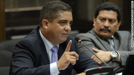 Juan Carlos Monzon, alleged leader of a customs corruption network, speaks during a hearing in court in Guatemala City on October 5, 2015. Monzon surrendered at the Supreme Court to face charges of conspiracy, customs fraud and passive bribery, said a spokeswoman for the court. Monzon, a private secretary to former Guatemalan Vice-President Roxana Baldetti, allegedly devised a scheme in which importers bypassed customs duties in return for bribes.  AFP PHOTO / ORLANDO ESTRADA        (Photo credit should read ORLANDO ESTRADA/AFP/Getty Images)