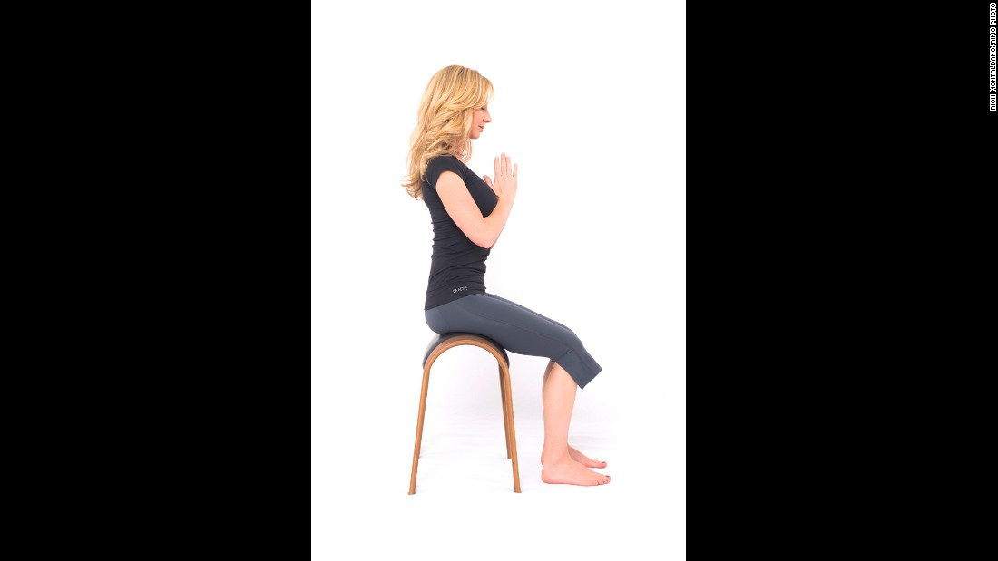 This position facilitates proper seated posture during breathing while also integrating a meditative focus.