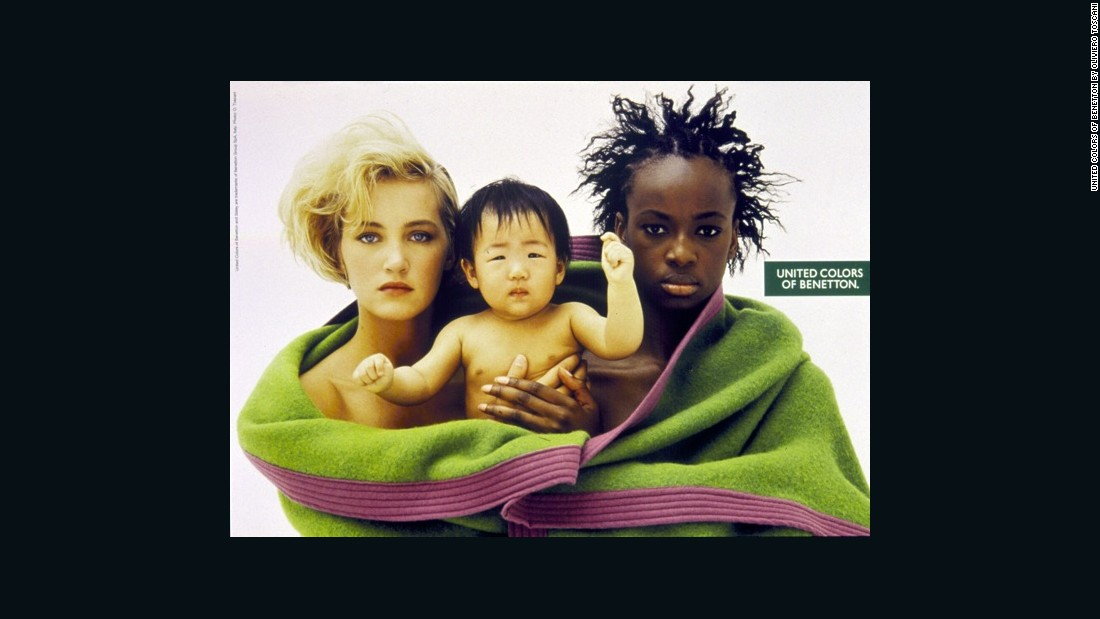 Oliviero Toscani equally challenged racial segregation within society, often placing people of different ethnicities alongside each other in family settings --  which still at that time had the power to shock. Here, he equally challenged heteronormativity; supposing the women depicted are both mothers of the child, in a two-fold challenge of societal norms.