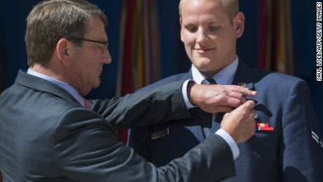 "(FILES) This September 17, 2015 file photo shows US Secretary of Defense Ashton Carter as he presents the Airman's Medal to Airman 1st Class Spencer Stone (R) for his role in disarming a gunman on a Paris-bound train during a ceremony at the Pentagon in Washington, DC. One of three Americans who helped thwart a terror attack on a packed passenger train bound for Paris has been stabbed in California, US media reported. CBS News first reported that Airman Spencer Stone had been ""repeatedly stabbed"". Quoting the US Air Force, NBC News said that Stone was in ""stable condition"" following the attack in Sacramento on the evening of October 7, 2015. AFP PHOTO / SAUL LOEBSAUL LOEB/AFP/Getty Images"