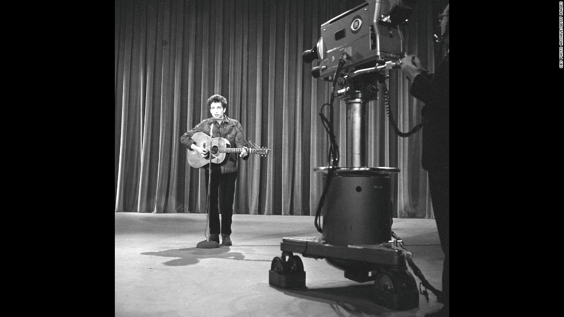 "In 1963, Dylan got the call performers dreamed about: an appearance on ""The Ed Sullivan Show,"" one of the most popular TV shows in the country. (A year later, <a href=""http://www.cnn.com/2014/01/30/showbiz/celebrity-news-gossip/beatles-ed-sullivan-50-years-anniversary/"">Sullivan would introduce the Beatles.)</a> At rehearsals, shown here, Dylan performed ""Talkin' John Birch Paranoid Blues."" But some CBS brass, <a href=""http://query.nytimes.com/mem/archive-free/pdf?res=9A06E5D8133CE63ABC4C52DFB3668388679EDE"" target=""_blank"">worried about controversy</a> over the song's mockery of the right-wing John Birch Society, were nervous, and <a href=""http://www.history.com/this-day-in-history/bob-dylan-walks-out-on-the-ed-sullivan-show"" target=""_blank"">Dylan declined to perform something else.</a> He never did appear on ""Sullivan."""