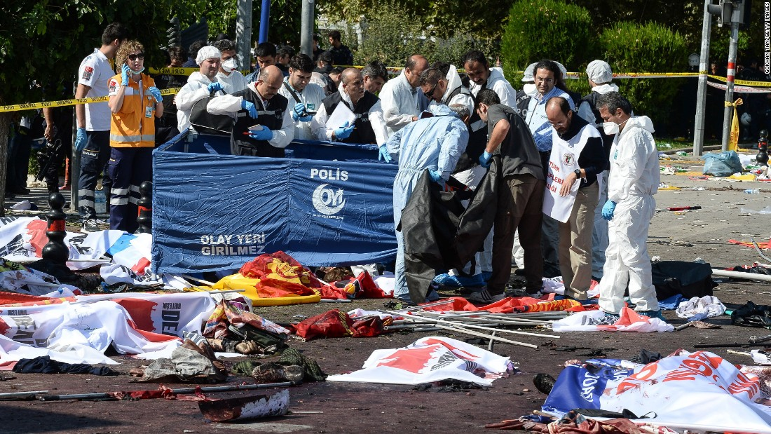 Turkish security forces and forensic police inspect the blast site.
