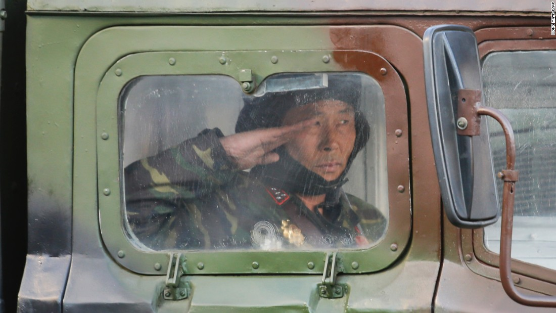 A North Korean soldier salutes during the military parade on Kim Il Sung Square.