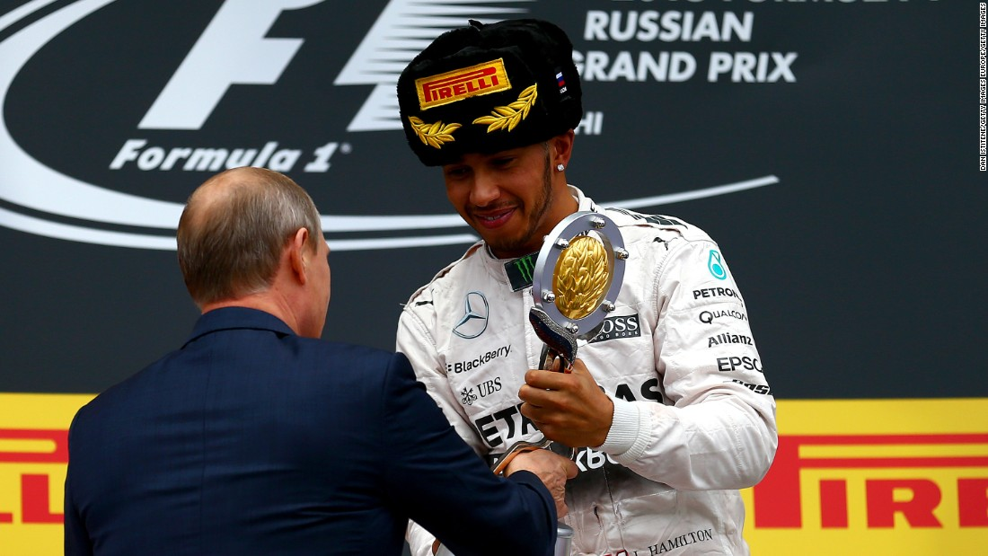 Putin presented Hamilton with the winner's trophy at the 2015 Russian Grand Prix.