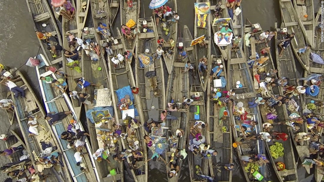 """Here is a picture of a group of vendors who wanted to sell things at the end of our boat,"" said photographer Moritz Ot of this image taken in the port city of Iquitos, on the banks of the Amazon River in Peru."