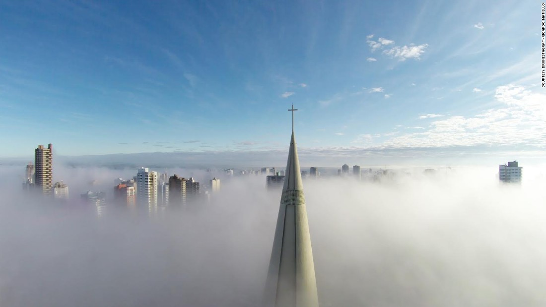"The steeple of Brazil's Maringa Cathedral can be seen peeking above the mist in this image by Ricardo Matiello. The stunning photo was also the winner of this year's <a href=""http://www.dronestagr.am/contest/"" target=""_blank"">Dronestagram Aerial Photography Contest</a>, in the Places category."