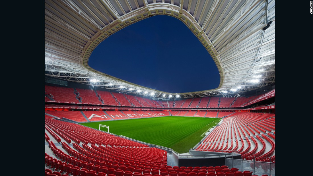 "This new stadium, which opened in 2013, replaced the old San Mames as home to the Athletic Bilbao football club. Principal architect Cesar Azcarate, speaks of the challenges of designing the new structure. ""The case of San Mames is very particular and interesting. We had to make a new stadium to replace the legendary San Mames, which was over 100 years old. We had to be able to move all the magic and the atmosphere of the old stadium (known as the ""cathedral"" of the Spanish league) into a modern one. That was our main challenge, and I think we succeeded."""