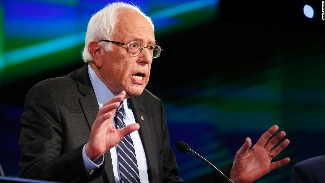 "Sanders speaks during the debate. CNN's Mark Preston said Sanders' opening remarks ""hit on all of the hot-button liberal issues: Take back the government from billionaires, climate change. He all but said it is time for a revolution."""